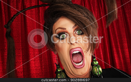 Screaming Man in Drag stock photo, Screaming man in drag over red curtain by Scott Griessel