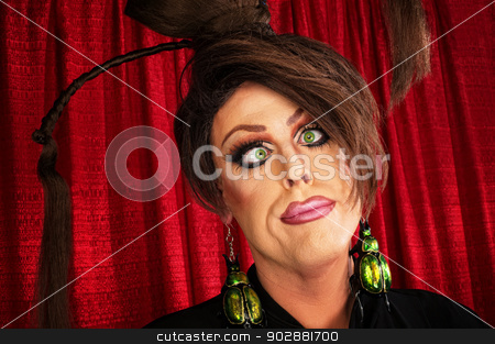 Man with Crossed Eyes stock photo, Funny man in female hairdo with crossed eyes by Scott Griessel