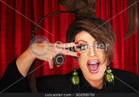 Laughing Drag Queen stock photo, Laughing Caucasian drag queen in theater with hand near face by Scott Griessel
