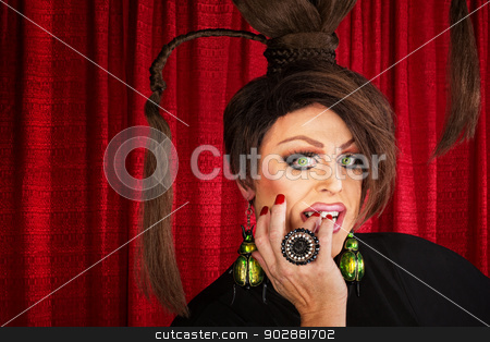 Drag Queen Staring stock photo, Beautiful drag queen staring and biting nails by Scott Griessel