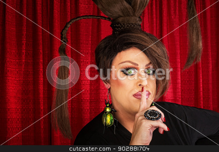 Man in Drag with Finger at Lips stock photo, Man in drag and funny hairdo with finger near lips by Scott Griessel