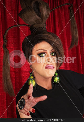 Woman Flicking Fingers stock photo, Annoyed man in drag and ponytails flicking fingers by Scott Griessel