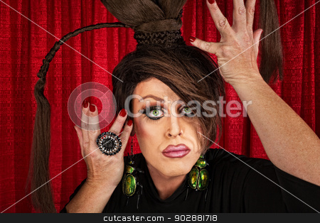 Dramatic Drag Queen stock photo, Big drag queen in theater fixing his hair by Scott Griessel