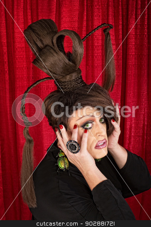 Frightened Drag Queen stock photo, Frightened drag queen with large beetle earrings and ponytails by Scott Griessel