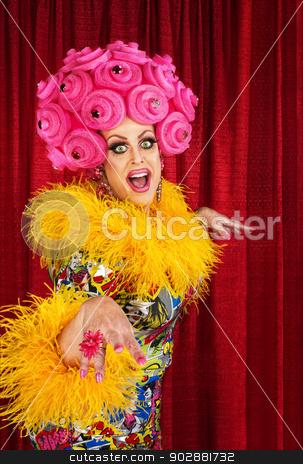 Happy Drag Queen stock photo, Happy dancing drag queen in pink foam wig by Scott Griessel