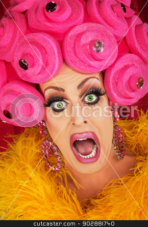 Screaming Drag Queen Close up stock photo, Screaming drag queen with pink foam wig in theater by Scott Griessel