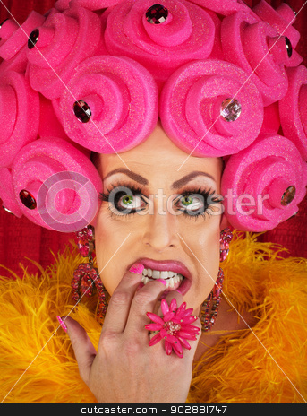 Man in Drag Biting Fingernails stock photo, Nervous drag queen in pink wig biting nails by Scott Griessel