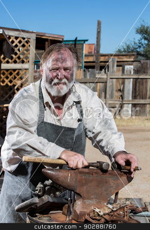 Old West Blacksmith stock photo, Old West Blacksmith Rests Hammer on Anvil by Scott Griessel