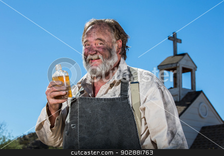 Old West Drunkard Drinks stock photo, Old West Drunkard Drinks a Bottle of Alchohol by Scott Griessel