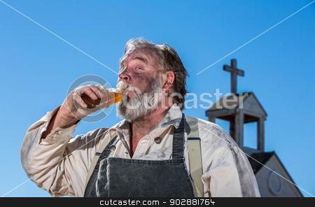 Old West Drunk Drinks stock photo, Old West Drunk Drinks a bottle of Liquor by Scott Griessel