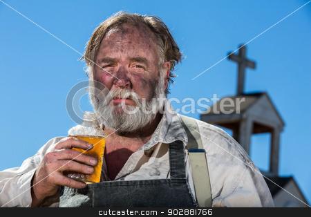 Old West Drunkard Drinks  stock photo, Upset Looking Old West Drunk Drinks Liquor by Scott Griessel