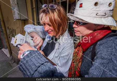 Female Tourists in Istanbul stock photo, ISTANBUL, TURKEY – APRIL 27: American Tourists on April 27, 2012 in Istanbul, Turkey.  Each year patriotic Turks honor those fallen at the battle of Galipoli during World War I. by Scott Griessel