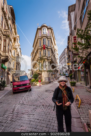 Tourist in Istanbul stock photo, ISTANBUL, TURKEY – APRIL 27: Building with flag and tourist on April 27, 2012 in Istanbul, Turkey.  Each year patriotic Turks honor those fallen at the battle of Galipoli during World War I. by Scott Griessel