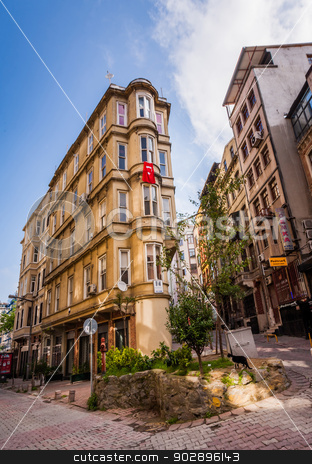 Istanbul Building with Flag stock photo, ISTANBUL, TURKEY – APRIL 27: Building with flag on April 27, 2012 in Istanbul, Turkey.  Each year patriotic Turks honor those fallen at the battle of Galipoli during World War I. by Scott Griessel
