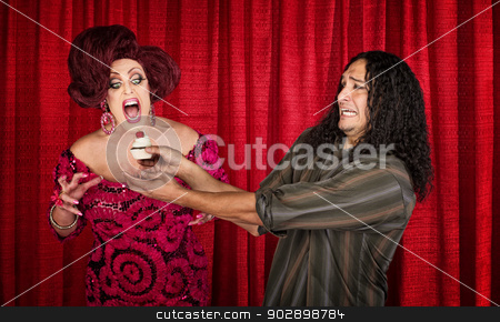 Excited Woman with Cupcake and Nervous Man stock photo, Nervous man holding cupcake for excited man in drag by Scott Griessel