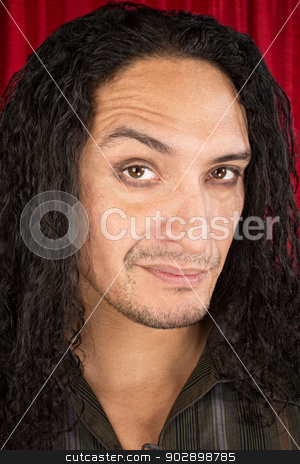 Skeptical Latino Man stock photo, Close up of skeptical Latino man with long hair by Scott Griessel