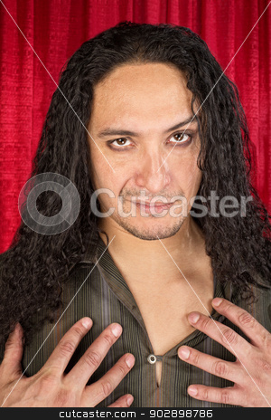 Sensual Latino Man stock photo, Close up of sensual Hispanic man with long hair by Scott Griessel