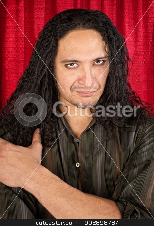 Handsome Latino Man stock photo, Attractive Latino man with long hair and eyeliner by Scott Griessel