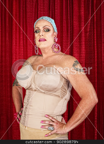 Tall Man in Drag stock photo, Tall white male in drag with tattoos on arms by Scott Griessel