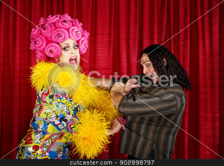 Desperate Drag Queen with Man stock photo, Excited drag queen in boa pulling on a man by Scott Griessel