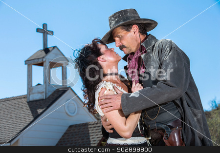 Romantic Old West Man and Woman stock photo, Romantic Old West Man and Woman Embrace by Scott Griessel