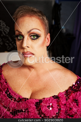 Female Impersonator Close-up stock photo, Serious drag queen without wig in dressing room by Scott Griessel