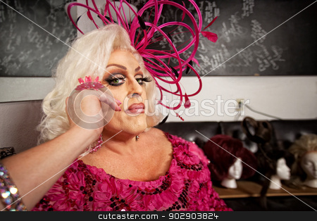 Serious Man in Drag stock photo, Serious man in blond wig and pink dress by Scott Griessel