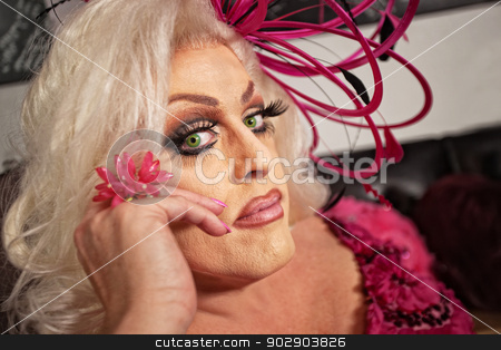 Close Up of Drag Queen stock photo, Close up of serious drag queen in blond by Scott Griessel