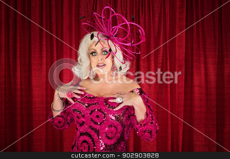 Tall Man in Blond Wig and Makeup stock photo, Cute tall man in blond wig and drag over maroon curtain by Scott Griessel