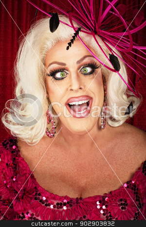 Big Cross-Eyed Woman stock photo, Cross eyed playful woman in blond wig and pink dress by Scott Griessel