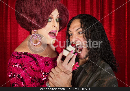 Hungry Man and Drag Queen stock photo, Tall drag queen and hungry man eating cupcakes by Scott Griessel