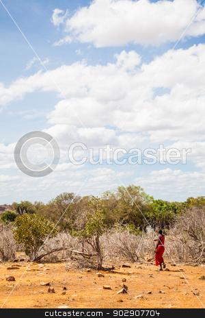 Masai in savanna stock photo, Kenya, Africa. Man of Masai ethnical group walking alone in savanna by Paolo Gallo