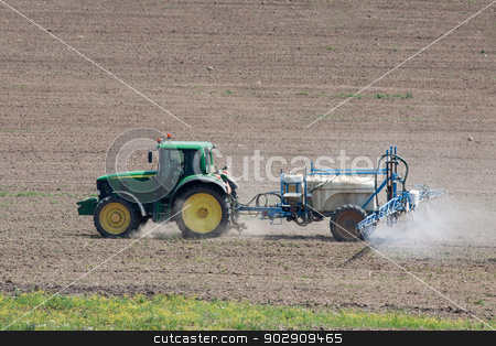 Tractor working on the field stock photo, Tractor fertilizes the field, detailed side view by Marian Bauer