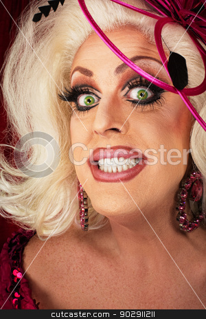 Smiling Woman with Long Eyelashes stock photo, Smiling blond drag queen with big eyelashes by Scott Griessel