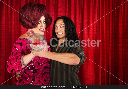 Man Dancing with Transvestite stock photo, Happy cross dressing man dancing with smiling boyfriend by Scott Griessel