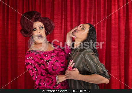 Man Harrassing a Transvestite stock photo, Man trying to kiss a transvestite is pushed away by Scott Griessel