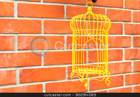 Yellow Birdcage on brick wall background. stock photo, Yellow Birdcage on brick wall background. by doraclub