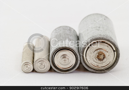 Old batteries on white background stock photo, Old grey batteries on white background (aa, aaa, b, c) by Jozsef Demeter