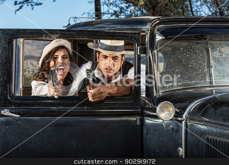 Tough Male and Female Gangsters stock photo, 1920s vintage gangsters in shoot out behind car door by Scott Griessel
