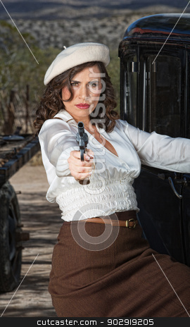 Pretty Lady Aiming Gun stock photo, 1920s vintage gangster woman aiming pistol by Scott Griessel