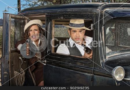 Gangster Woman Firing Gun From Car stock photo, 1920s female gangster firing machine gun from car with partner by Scott Griessel