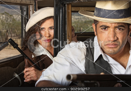 Tough 1920s Gangster Couple stock photo, Tough 1920s gangster male and female partners by Scott Griessel