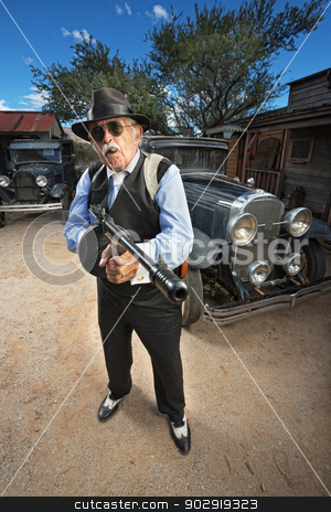 Tough Mature Gangster stock photo, Tough mature mob gangster with cigar and machine gun by Scott Griessel