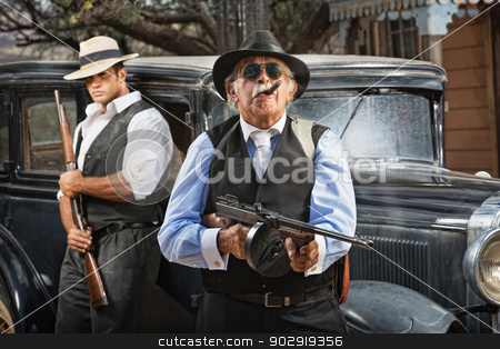 Serious Mob Boss stock photo, Serious mob boss with gun and guard near car by Scott Griessel