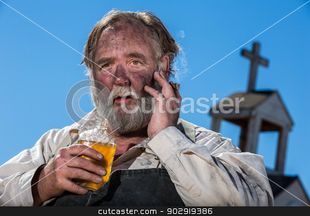 Old West Drunk stock photo, Upset Looking Old West Drunk Drinks Liquor by Scott Griessel