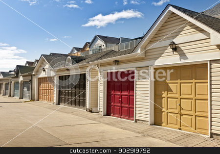 Row of parking garages stock photo, Row of garage doors at parking area for townhouses by Elena Elisseeva
