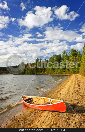 Red canoe on lake shore stock photo, Red canoe on beach at Lake of Two Rivers, Ontario, Canada by Elena Elisseeva