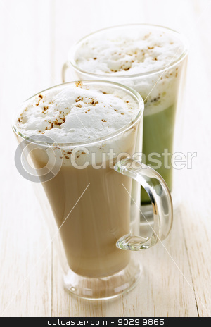 Chai and matcha latte drinks stock photo, Two specialty tea latte beverages of chai and matcha teas by Elena Elisseeva