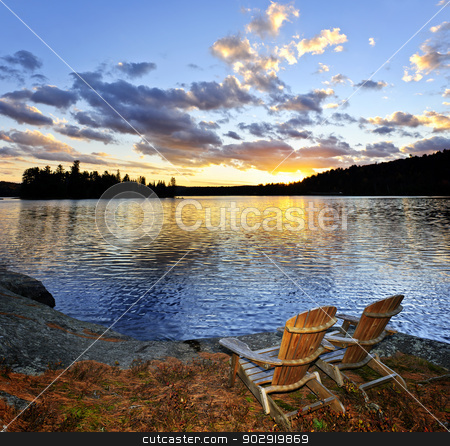 Wooden chairs at sunset on beach stock photo, Wooden chair on beach of relaxing lake at sunset in Algonquin Park, Canada by Elena Elisseeva