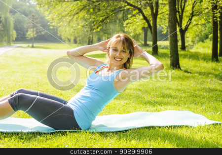 Woman doing situps in park stock photo, Female fitness instructor exercising doing sit-ups on yoga mat outside in green summer park by Elena Elisseeva
